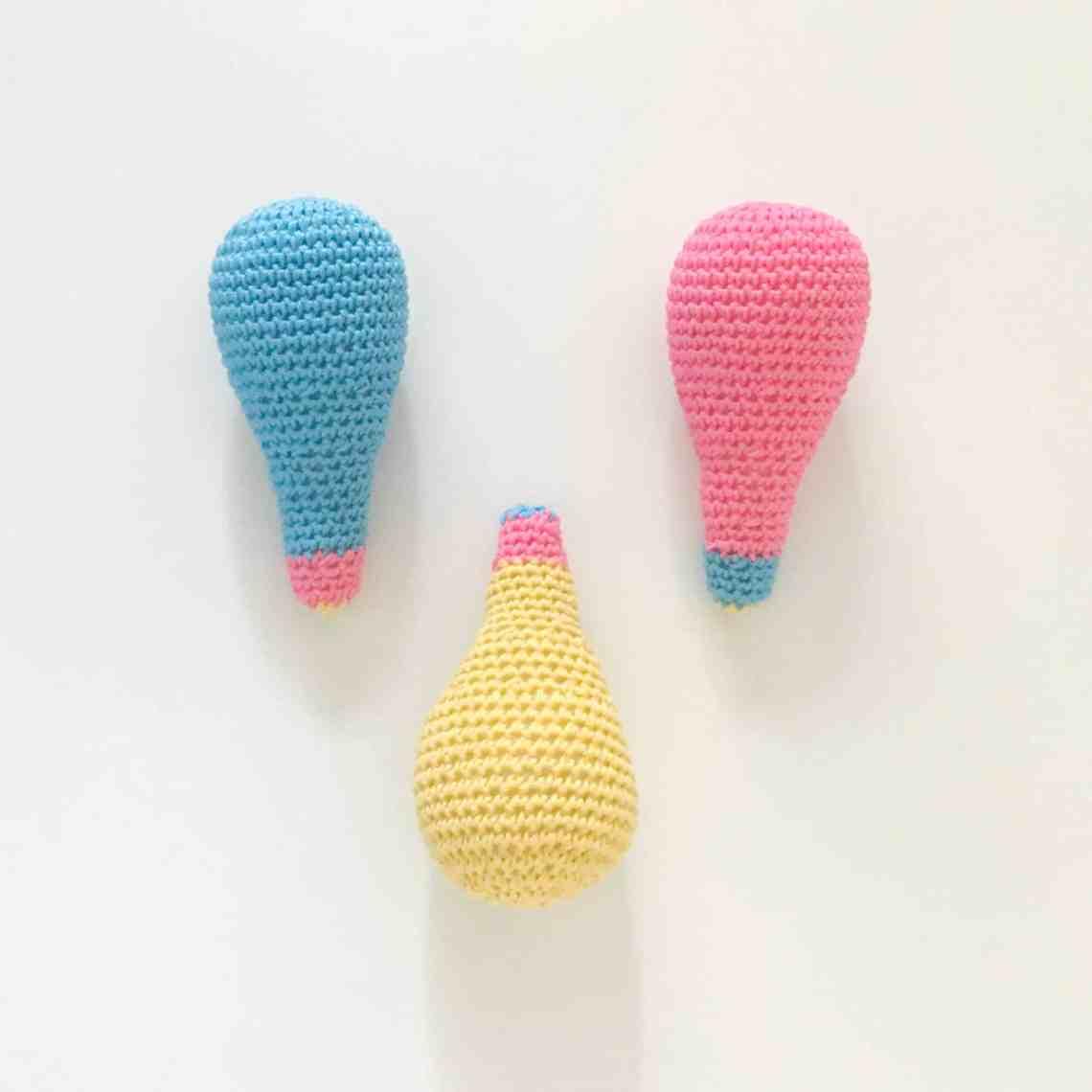 3 colourful crochet lightbulbs on a white background
