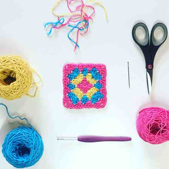 Crochet granny square and cotton yarn