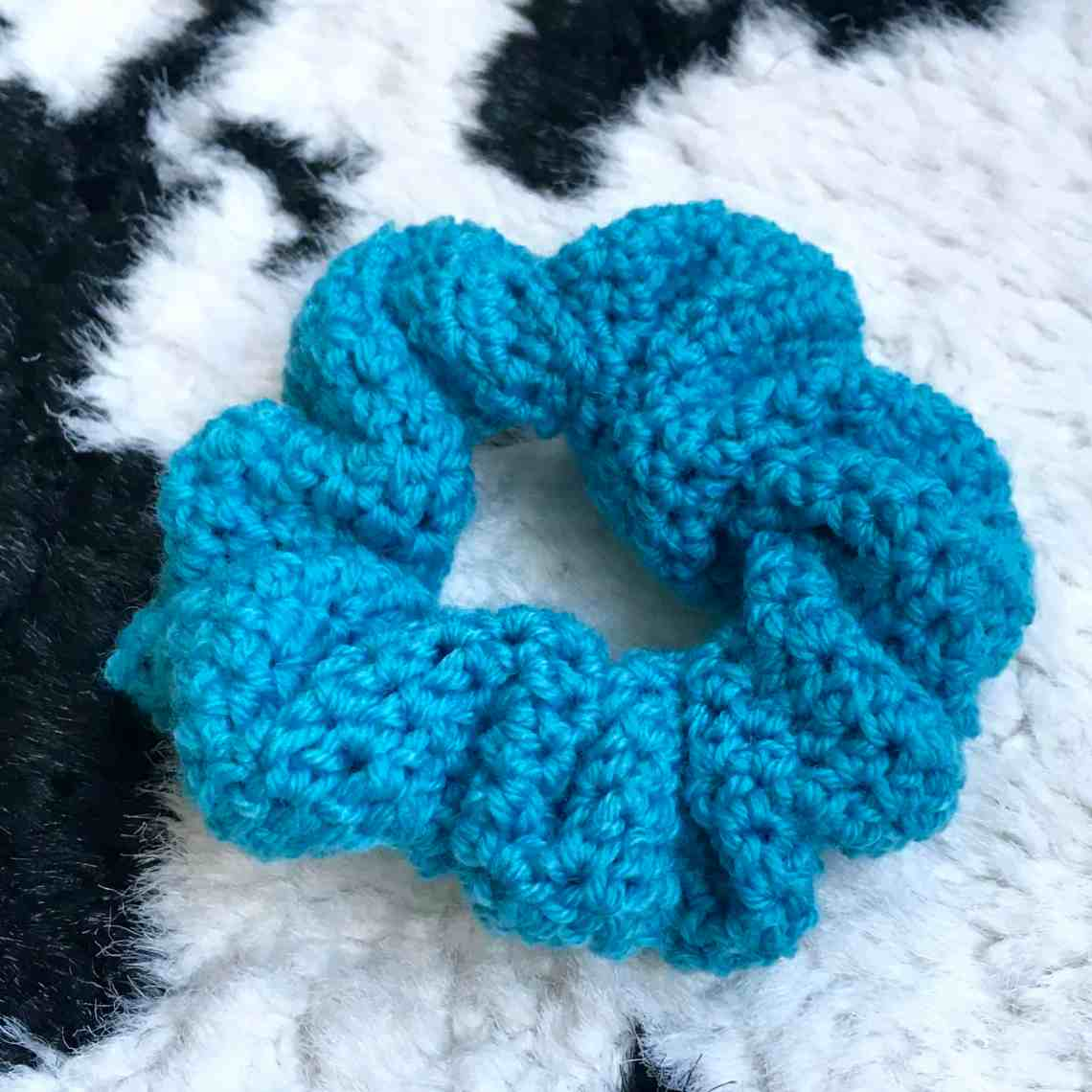 Blue crochet Scrunchie on animal print throw