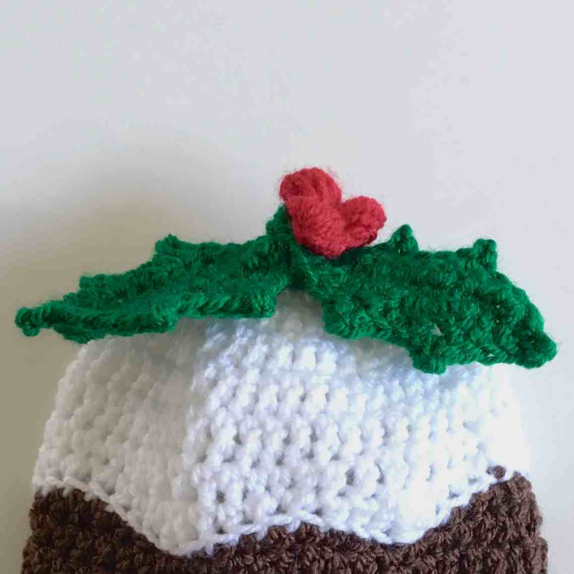 crochet christmas pudding hat with holly sprig and berries
