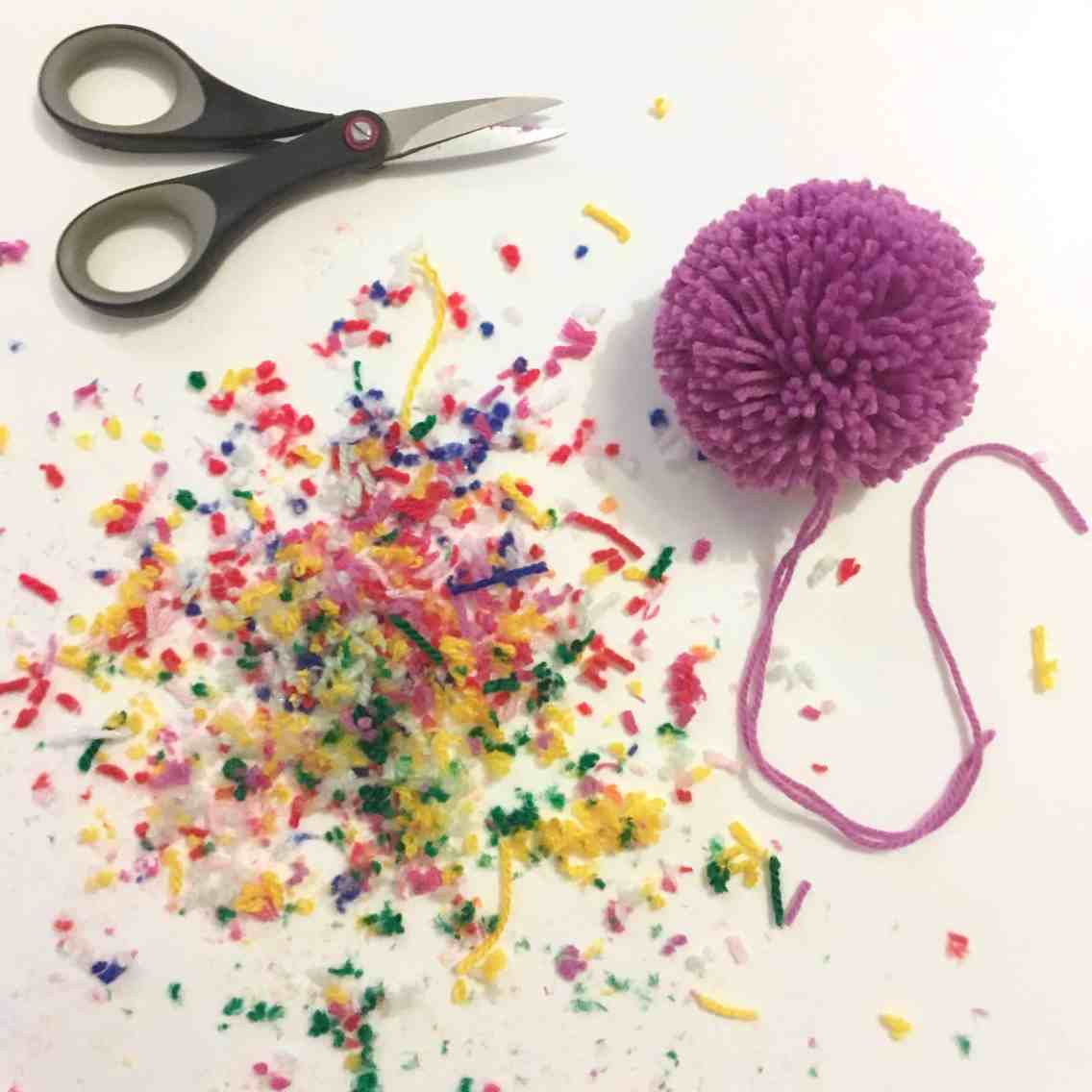 dust from pom pom and scissors
