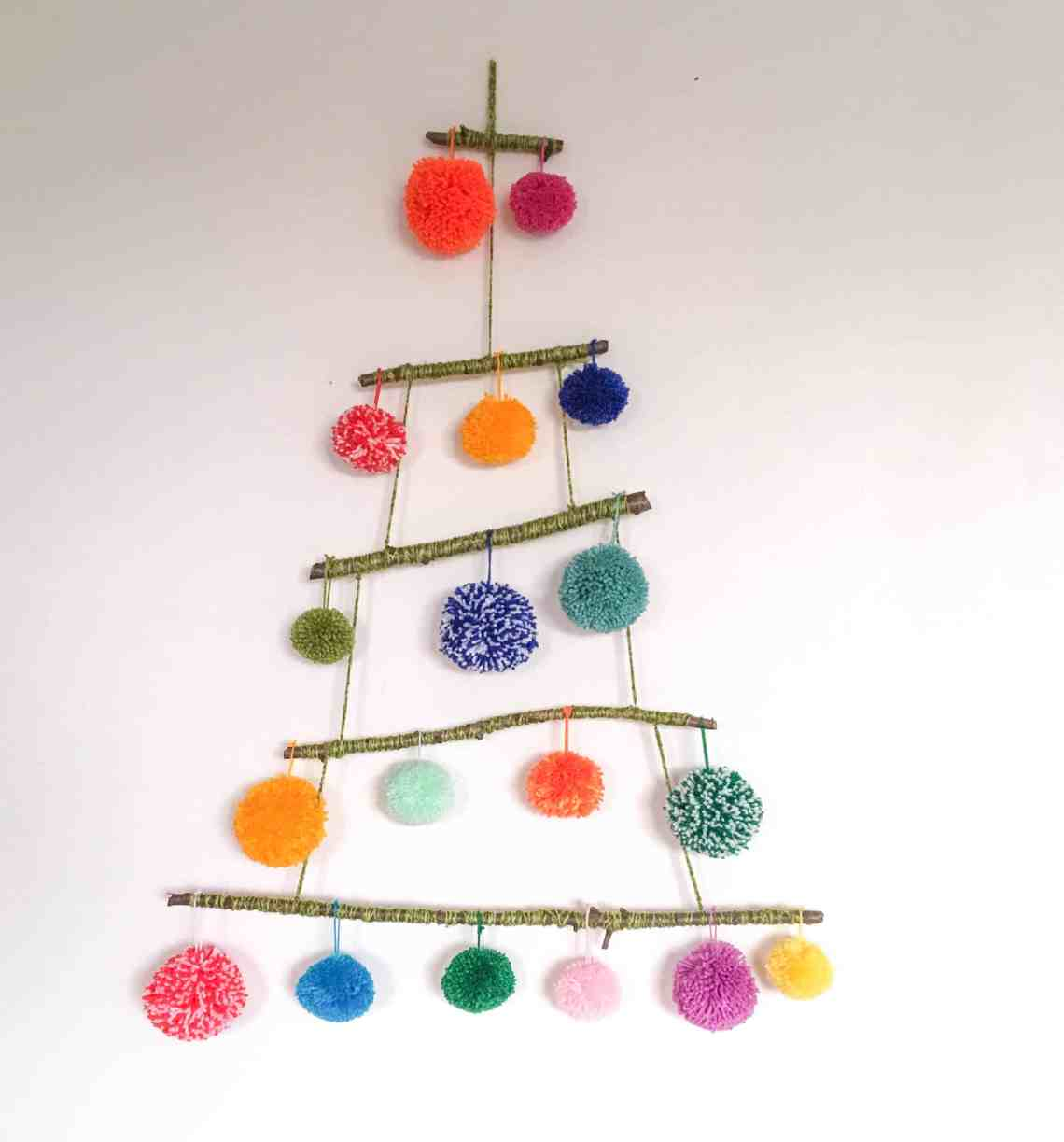Pom-pom tree alternative christmas tree using sticks left over yarn