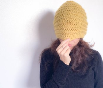 beehive beanie hat pulled over girls face