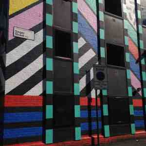 street art from camille walala bright colour stripes
