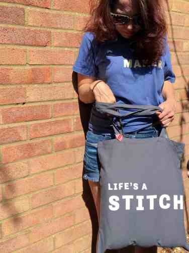 Lifes a stitch slogan tote with seamstress pin