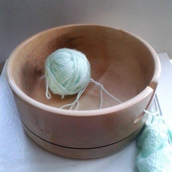 Wooden yarn bowl with yarn