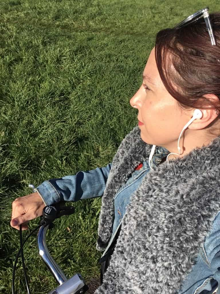 Girl on bike in faux cur crochet scarf
