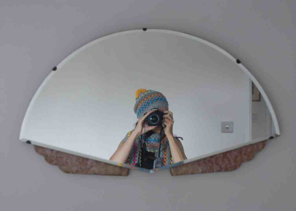 Rainbow and grey crochet pom pom hat photo taken in mirror