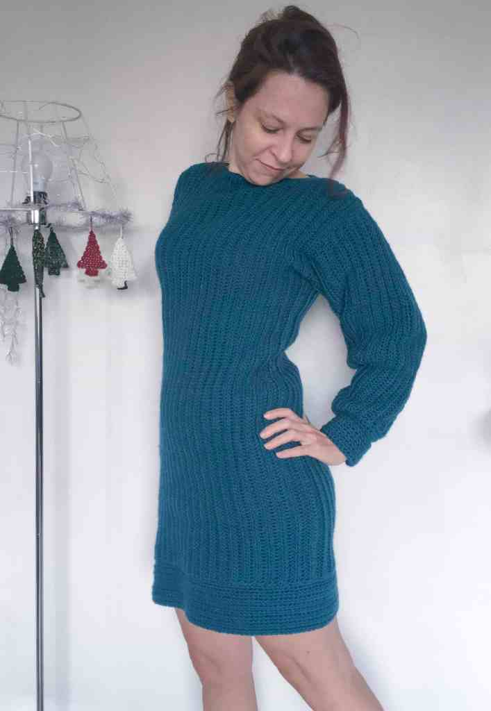 Girl in ribbed crochet jumper dress