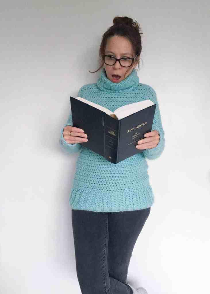 Woman wearing crochet sweater is scandalised by book