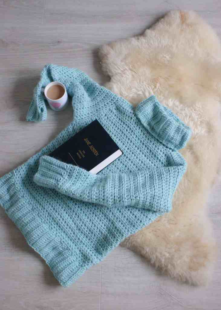 Crochet Sweater in Aqua on sheepskin rug