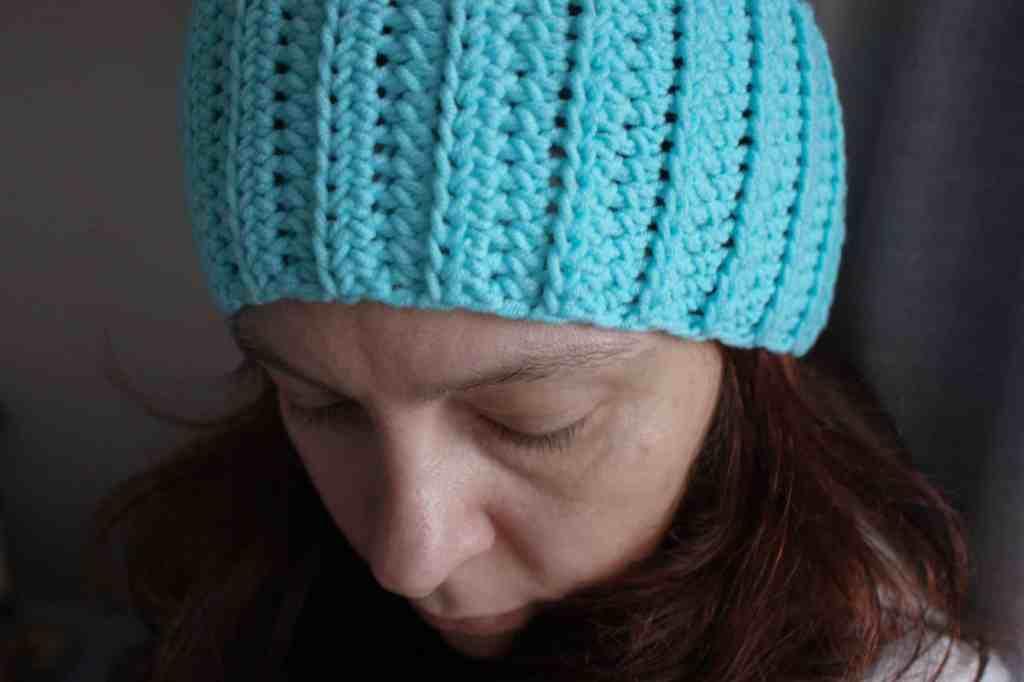 Woman wearing ribbed crochet ear warmer