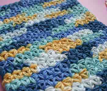 Crochet Jasmine Stitch multi coloured snood and crochet hook