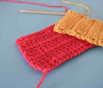 Linked double and half double crochet swatches yellow and red with wooden crochet hook