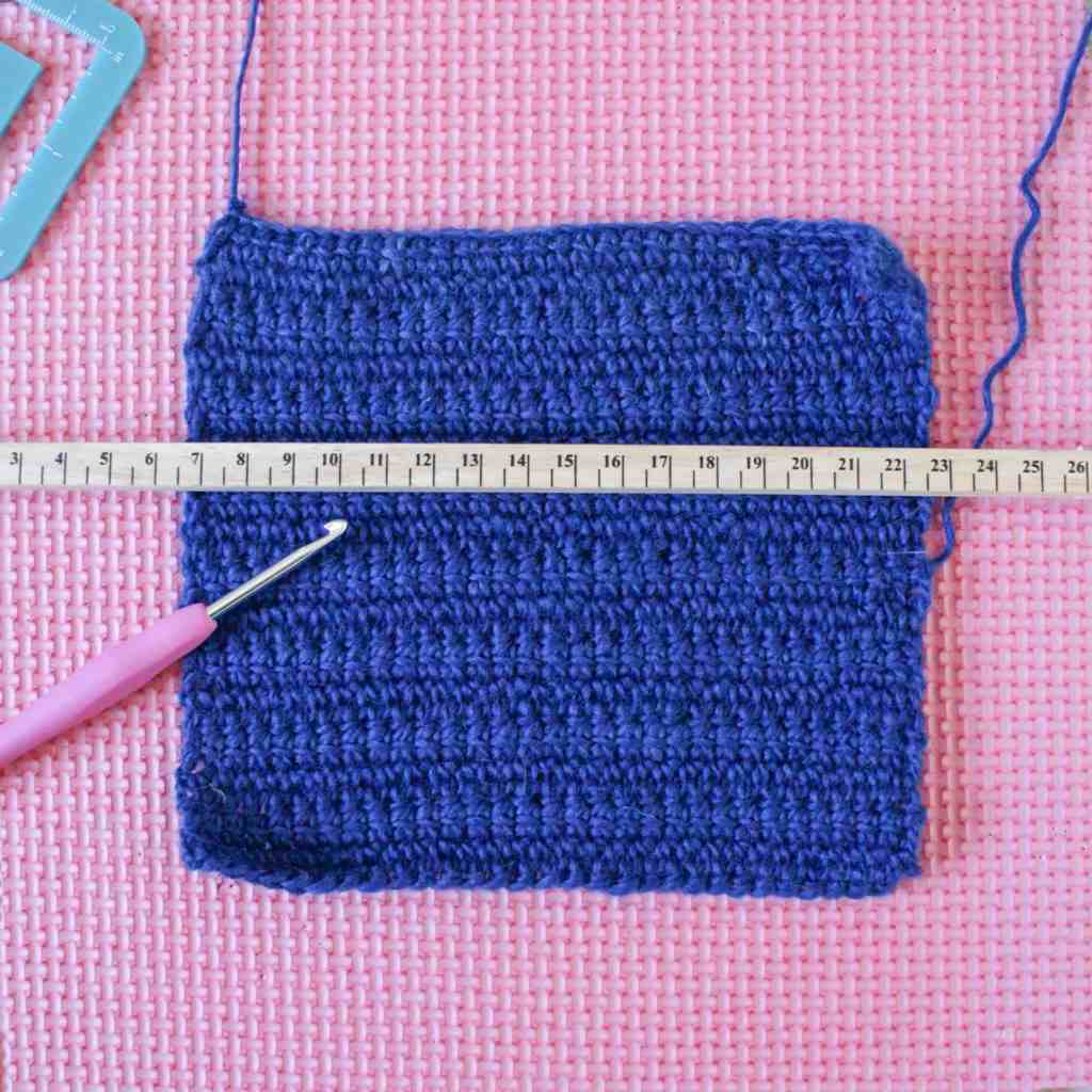 Ruler and crochet hook on blue fabric swatch