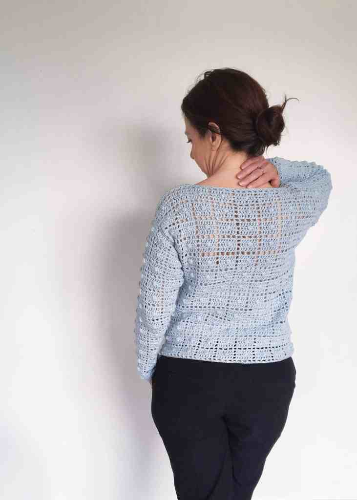Tribute Crochet Sweater from the back