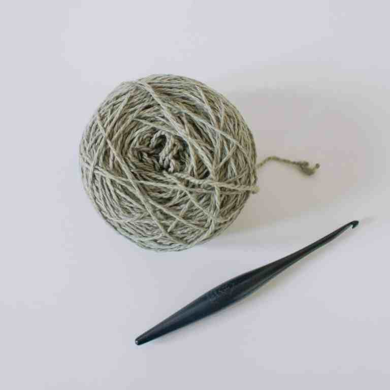 Ball of yarn and crochet hook