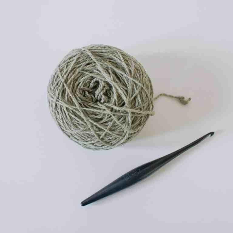 Ball of yarn and crochet hook