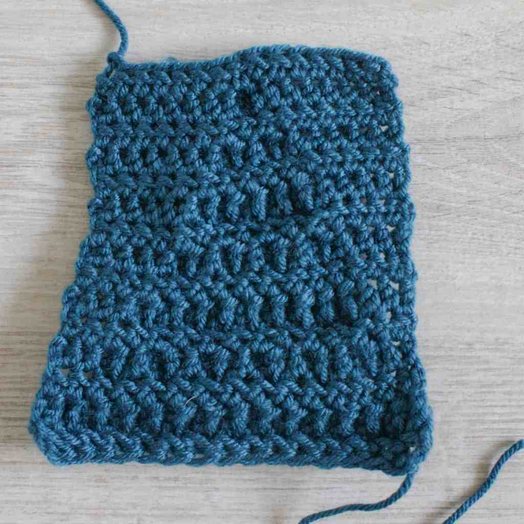 Back / wrong side of a crochet cluster stitch swatch