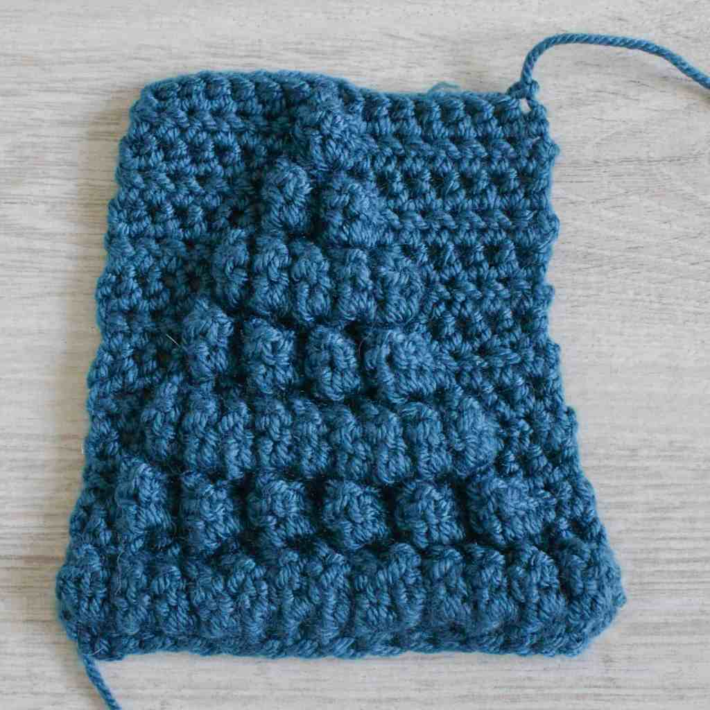 Front / right side of the blue crochet popcorn stitch swatch