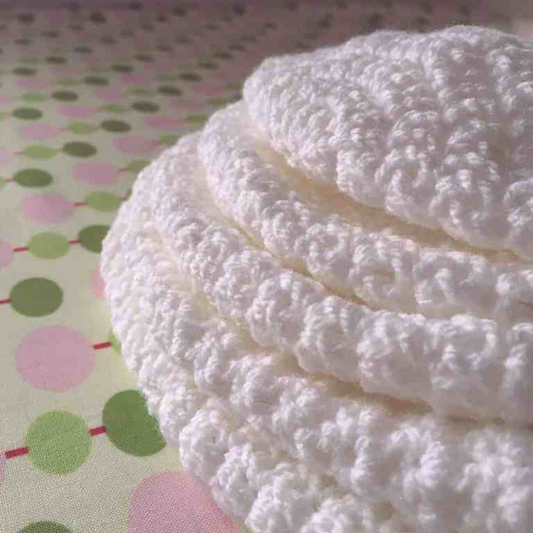 pile of white crochet hat crowns