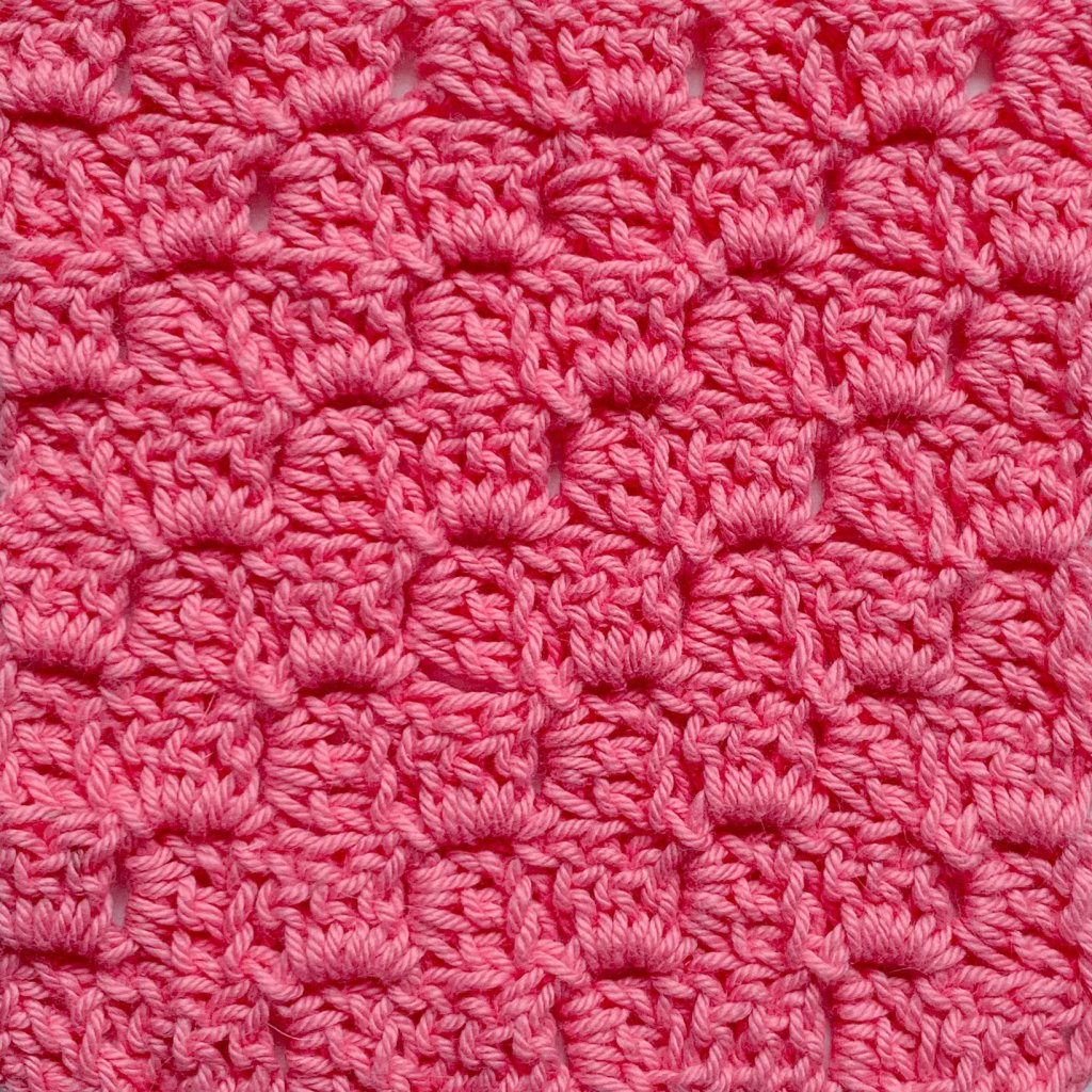 Close up of corner to corner crochet swatch in pink