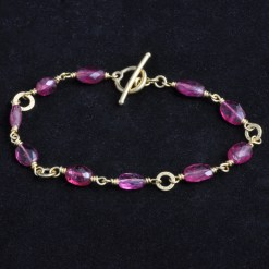 faceted pink tourmaline bracelet with gold chain detail