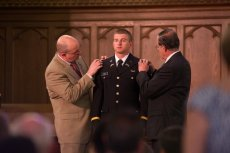 Cadet Nelson Lalli receives his lieutenant bars from his father, Blake Lalli and his uncle, LTC (Ret.) John Lalli photo by Stanley Leary