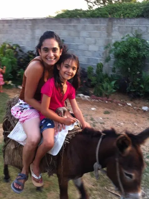 Riding donkey in Haiti