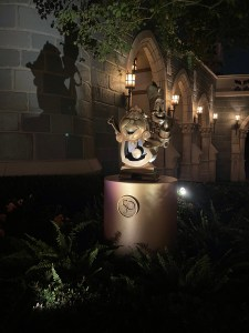 lumiere and cogsworth statues