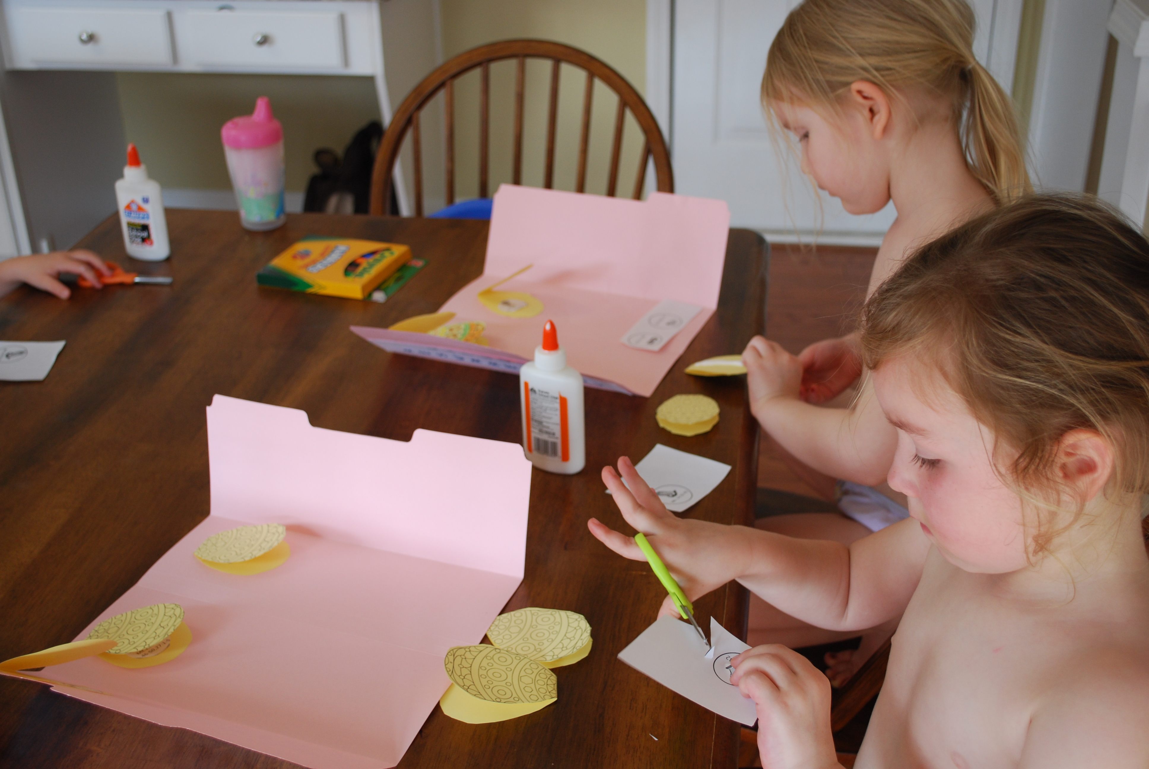 Katherine and Ruby over at the table working on their Resurrection Eggs booklet.