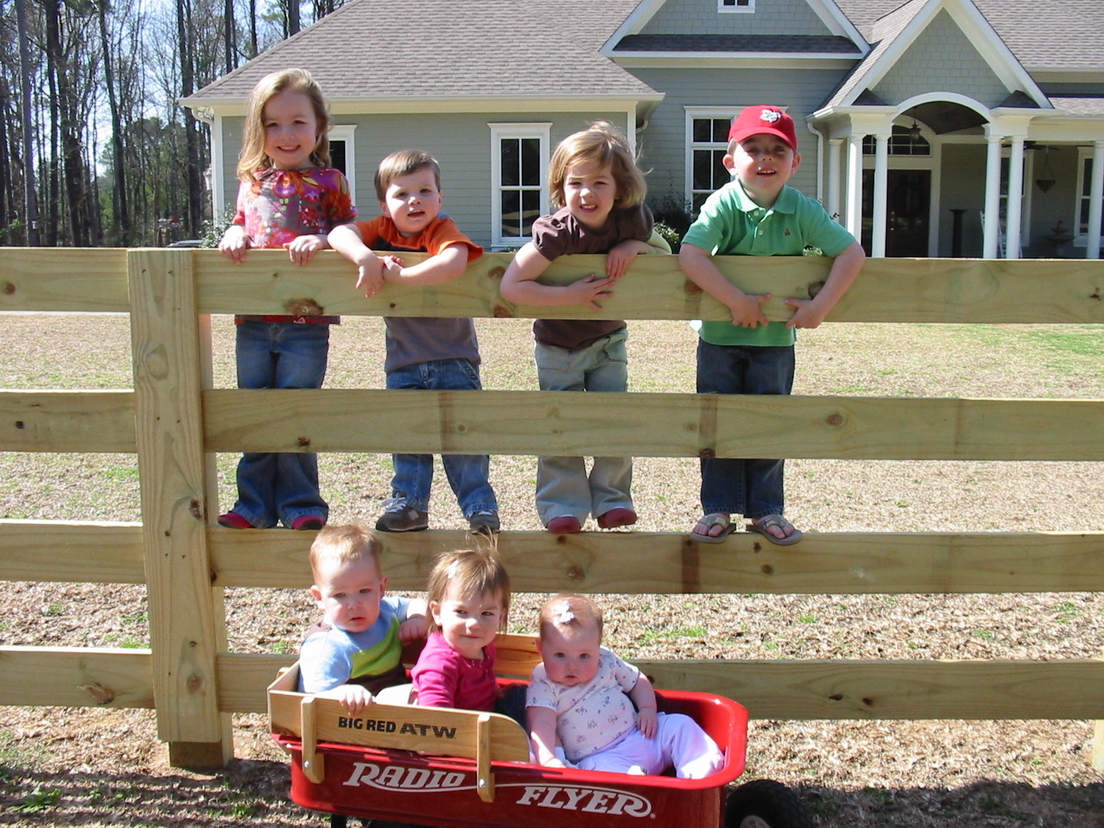 All SEVEN cousins at Sweetie and PawPaw's house on their new fence