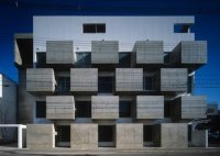 Urban Cubism: Concrete Blocks Form a Functional Facade