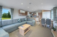 THE LOUNGE IS MADE FOR COMFORT WITH DOUBLE CORNER SOFA WITH PULL OUT DOUBLE BED