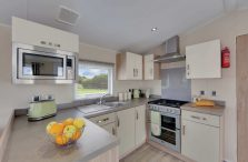 PRACTICAL U-SHAPED KITCHEN HAS OODLES OF WORK SURFACES, CUPBOARDS AND INTEGRATED APPLIANCES