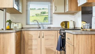 FULLY INTEGRATED KITCHEN WITH MICROWAVE, GAS COOKER AND FULL SIZE FRIDGE/FREEZER