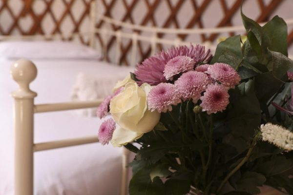 Flowers at the Foot of a Bed