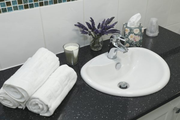 Running Sink and Clean, Warm Towels