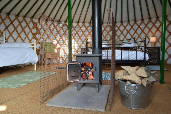 Wood Burner Warming a Yurt In Winter