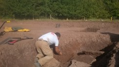 Julian finding the edge of one of the layers in a ditch segment.