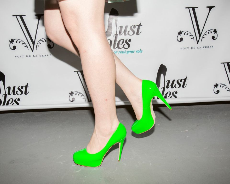 Woman wearing bright green high heels