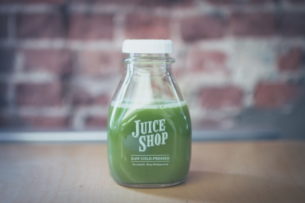 Green juice in a glass bottle
