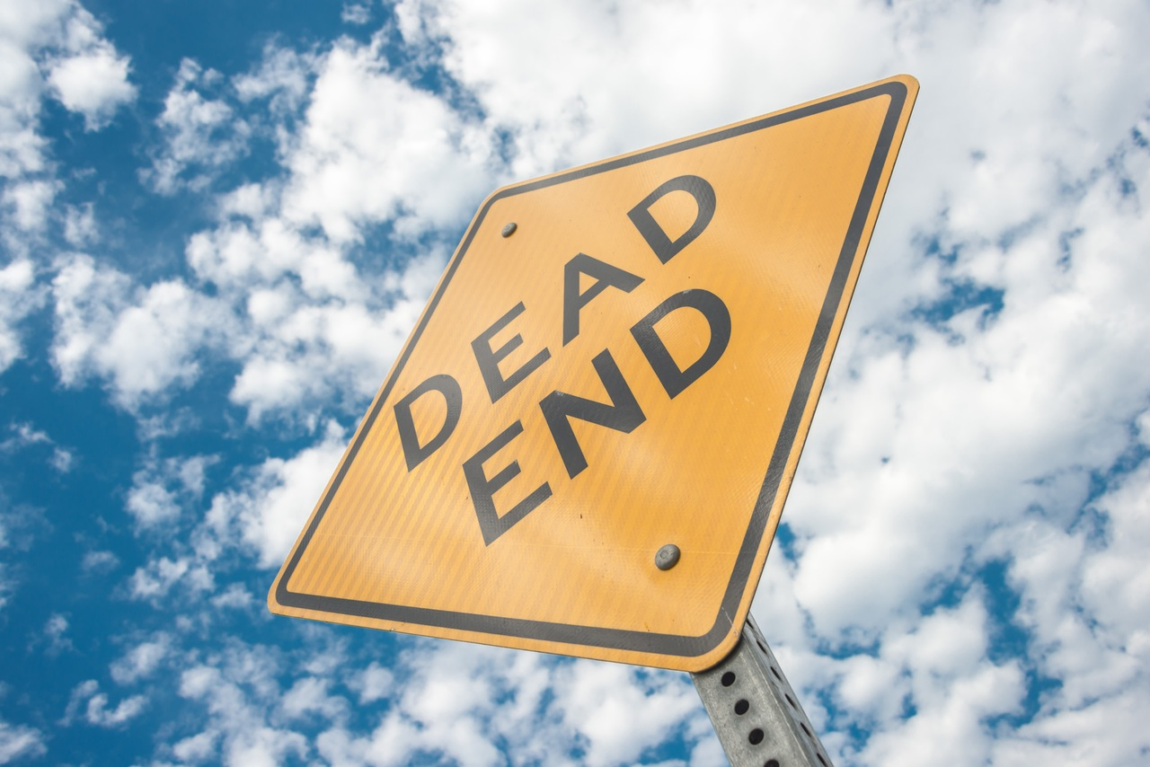 Dead end sign with cloud background