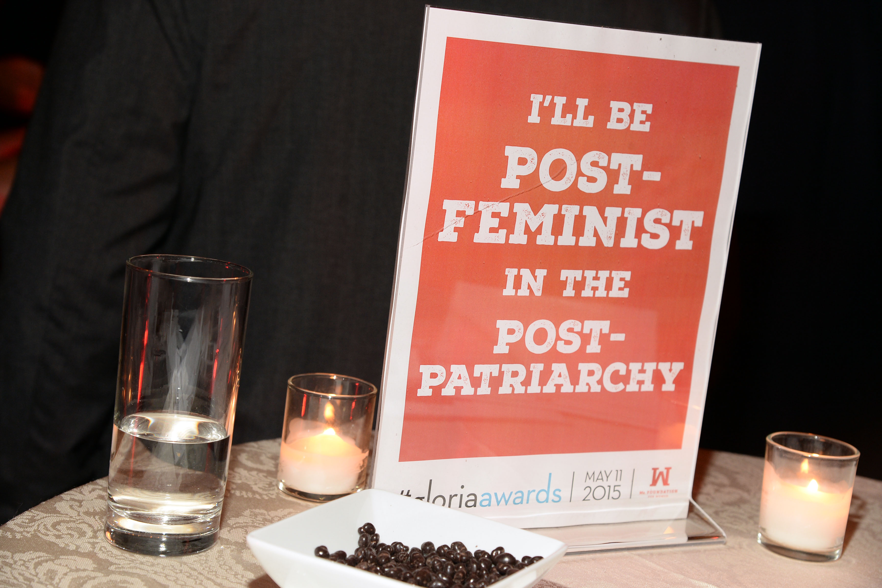 Feminist poster on event table with candles