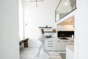 Kitchen with blurred human figure