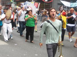 """9/21/14 New York, NY - """"Oil addiction is human extinction!"""" A protester, right, yells while walking at the People's Climate March."""