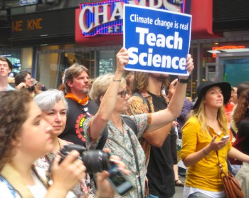 9/21/14 New York, NY - A protester calls for proper education about climate change at the People's Climate March.