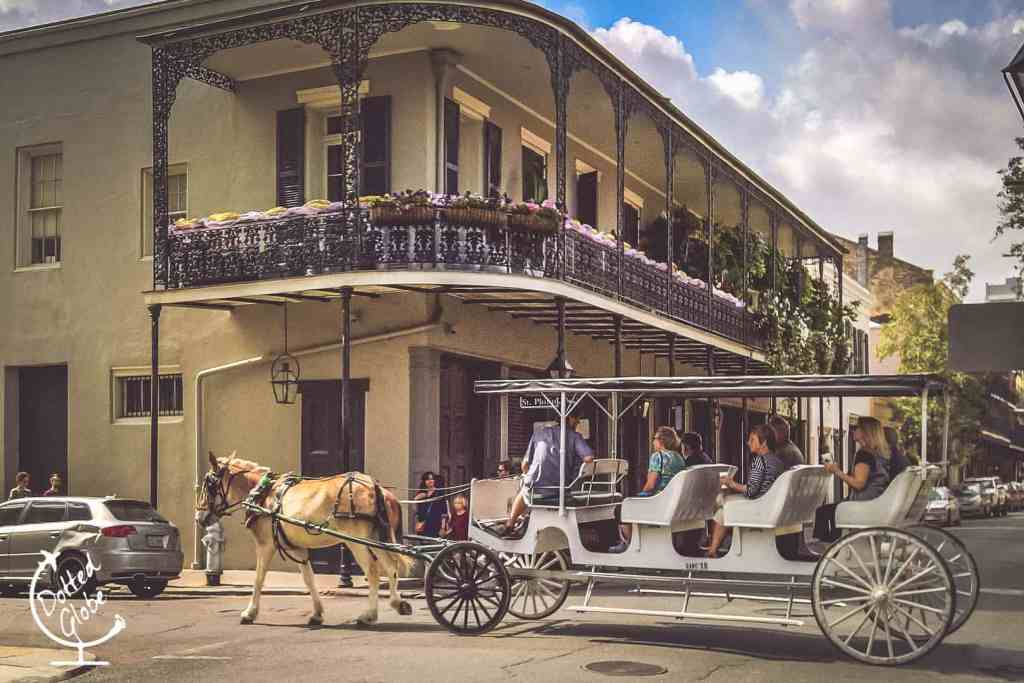 Horse drawn carriage passing through French Quarter New Orleans