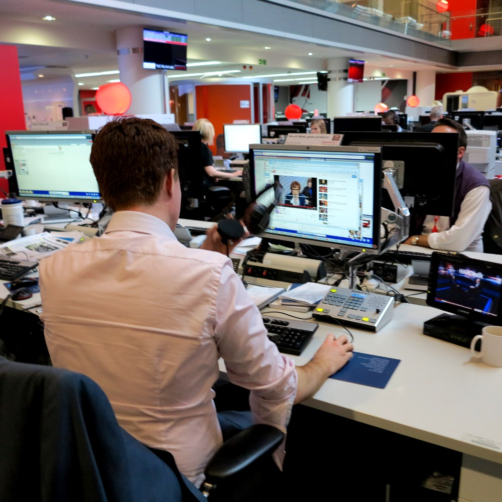 Me hard at work in the mosh pit, the big open plan newsroom at the heart of BBC's New Broadcasting House