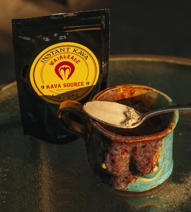 DoubleBlind: Bag of Potent Kava extract with a spoon full of kava resting on top of a mug.